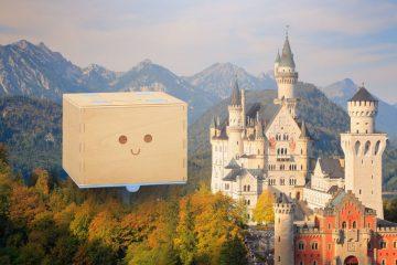 Imagen de un castillo en una montaña con el robot, Cubetto se va de vacaciones