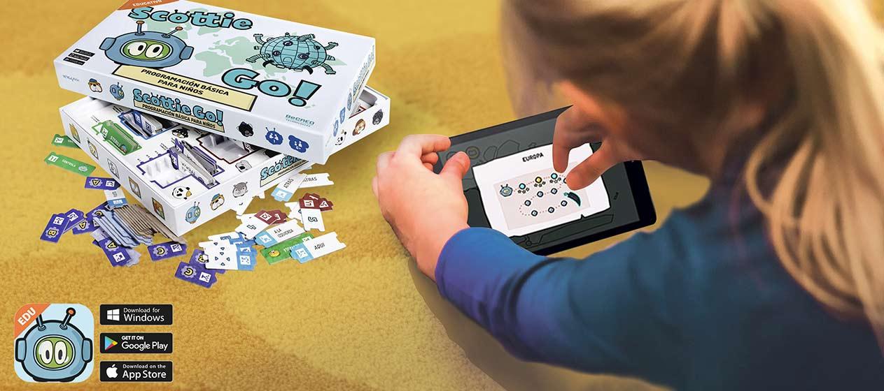 imagen de caja fichas y tableta con una niña jugando con Scottie Go!