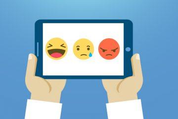 Tablet con tres emoticones para trabajar inteligencia emocional