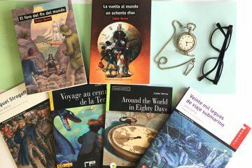 Diferentes libros con la obra de Jules Verne